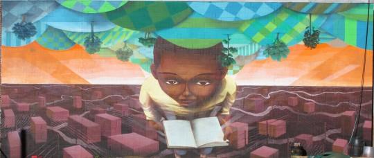 Street-art-Kid-Reading-a-Book-540x228